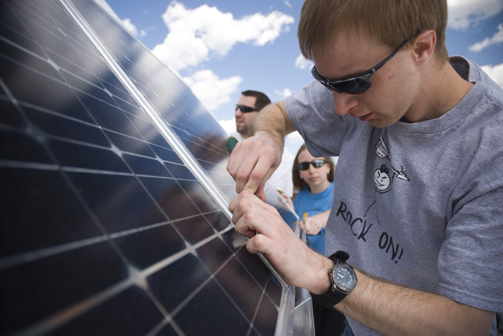 Student Nicholas Eurich installs a solar panel at Northland College in Ashland, Wis., as part of a photovoltaic class. The college offers a distinctive environmental liberal arts curriculum and is committed to apply in practice what it teaches about developing a sustainable future. The college gets support from Kresge grantee Second Nature.