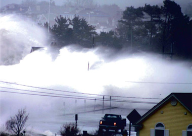 A storm surge crashes over coastal New Hampshire, one of the states where public officials are trying to prepare for the impacts of climate change.