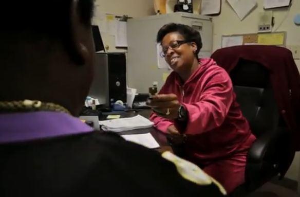 Eunice Boynton hands a new tenant a key at the apartment facility she helps manage.