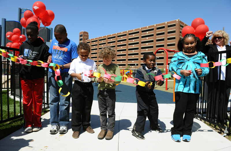 Six of the children who helped design the new RiverFront Play Park in downtown Detroit cut a paper-chain ribbon to officially open the park for all kids. From left to right: Olivia Holt, 14, Otis Holt, 11, Connor Robinson, 8, Finn Owsley, 5, Logan Robinson, 6, and Loren Smith, 8.