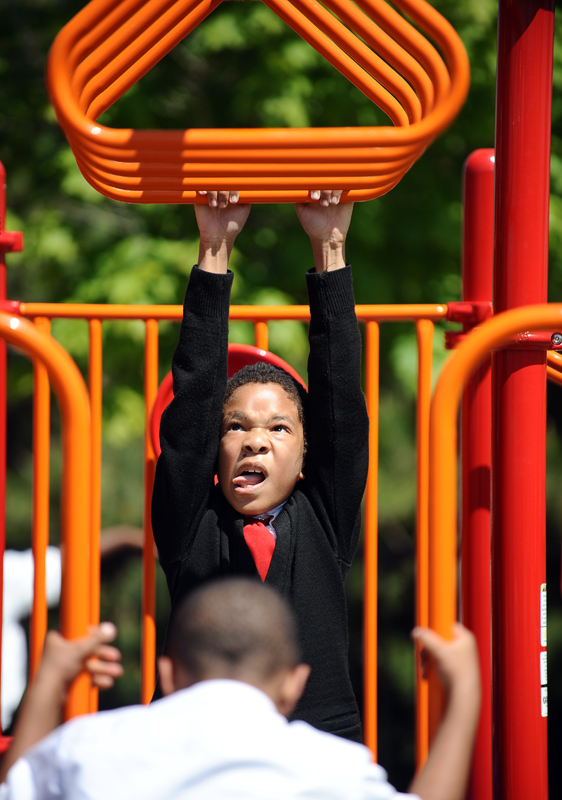 Detroit Edison Public School Academy student Kevin Chisolm, 9, shows how play can be hard work.