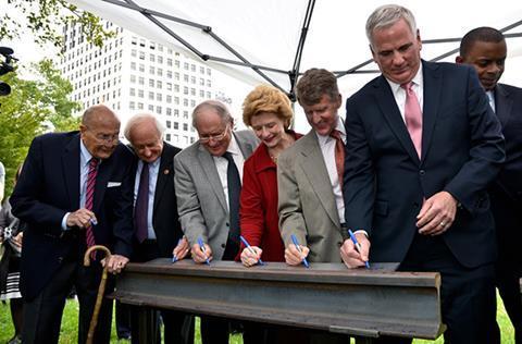 Transit leaders signing M-1 Rail document.