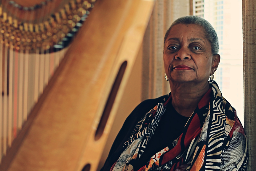 Patricia Terry-Ross at home with her harp