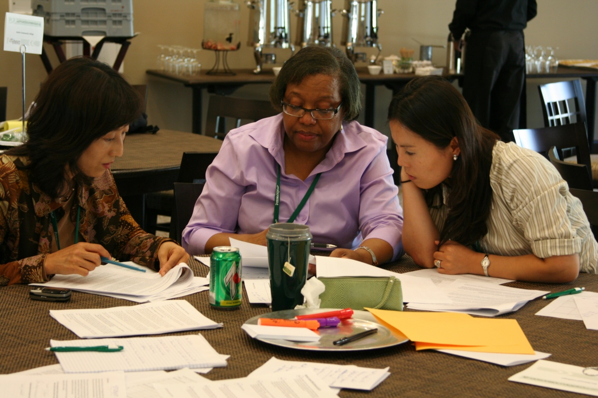 Community college math instructors work together to review curriculum at the Statway Summer Institute at Stanford University.