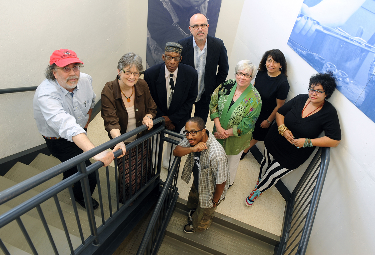 The 2013 Literary Arts Fellows: (from left) Cary Loren, Terry Blackhawk, Arthur LaBrew,  Chace Morris (on stairs), Michael Zadoorian, Carolyn Walker, Dunya Mikhail, Adrienne Maree Brown.
