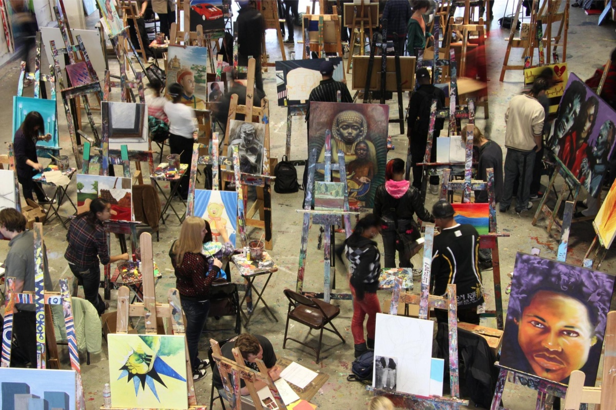 Students work on paintings at Artists for Humanity's EpiCenter in Boston.