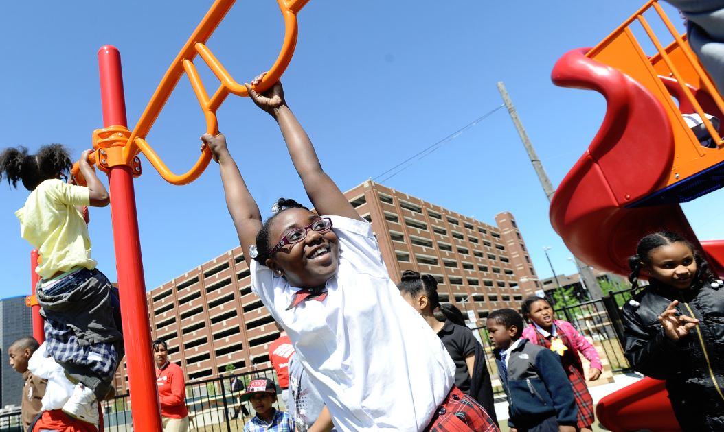 Children flocked to playground equipment supplied by KaBOOM! at a recently opened playpark in Detroit.