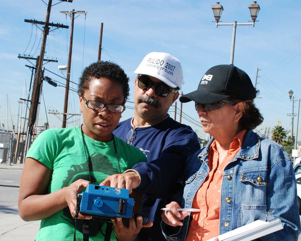 "Residents use a device called a ""Dust Trak"" to check the air quality in Wilmington, Calif., near Los Angeles. The Liberty Hill Foundation's Common Agenda program is mobilizing grass-roots organizations to clean up and green up low-income and minority communities affected by emissions from nearby industries and transportation hubs."
