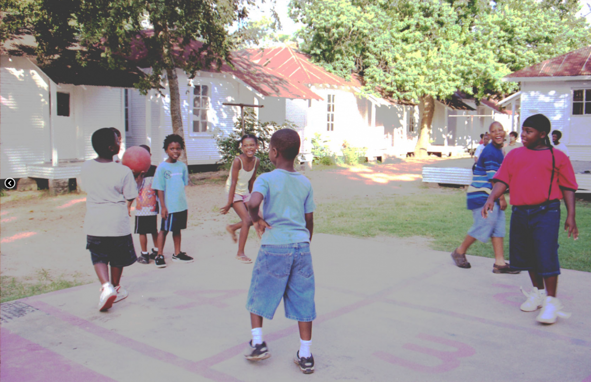 "Children play at Project Row Houses. Co-founder Rick Lowe has referred to the development – residents included – as a ""social sculpture."""