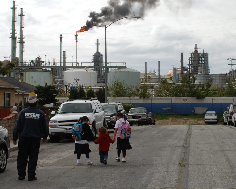 A photo shows the proximity of industrial activity to homes in Wilmington, Calif., near Los Angeles, where the Liberty Hill Foundation and  its partners are promoting local environmental-health and land-use policies that will reduce pollution and the health problems it causes.