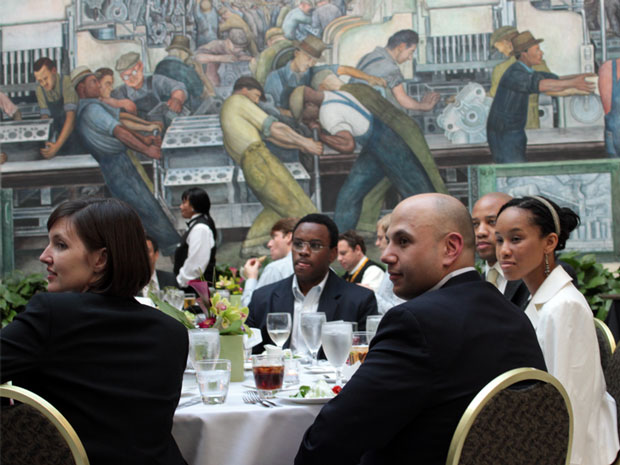 Prospective Fellows listen to a speaker during a dinner at the Detroit Institute of Arts in May.