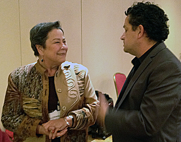 Guillermina Hernandez-Gallegos, director of Kresge's Human Services Program, talks with Luis Granados, executive director of Mission Economic Development Association in San Francisco at the close of the Kresge gathering,