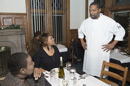 Chef Clinton Moore talking with two diners at the Gathering restaurant