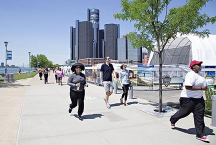 Detroit RiverWalk people walking and jogging