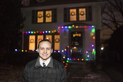 Joe Kvoriak in front of home with Christmas lights in Grandmont-Rosedale
