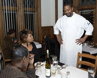 Chef talking with satisfied customers