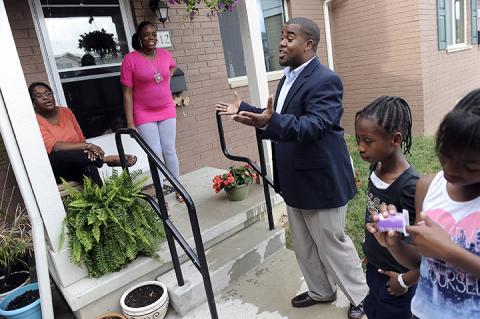 Marquan Jackson talks with neighbors