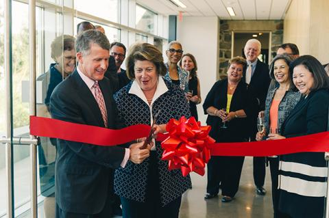 Rip Rapson and Elaine Rosen cutting ribbon at dedication ceremony