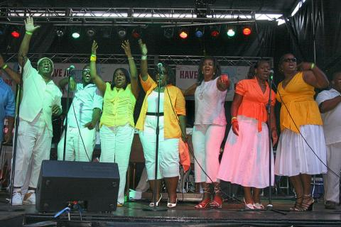 Gospel choir standing on stage singing