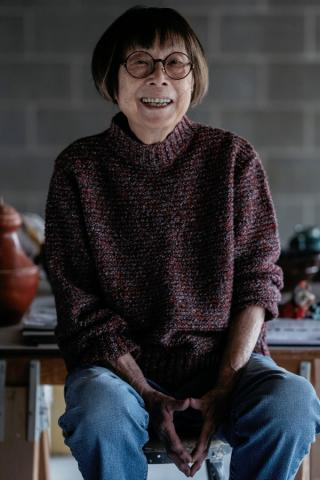Marie Woo in the basement of her home.