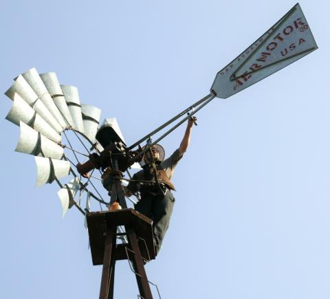 Melvin Troyer of Sugarcreek, Ohio, works on one of the windmills on Kresge's headquarters campus.