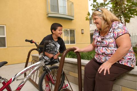 Residents of a permanent supportive housing apartment complex in Los Angeles, built and managed by A Community of Friends