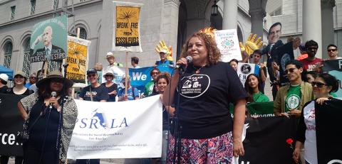 A rally calling for equitable climate resilience work