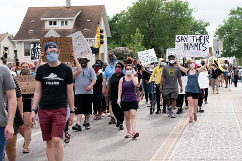 People protesting against police violence after the death of George Floyd.