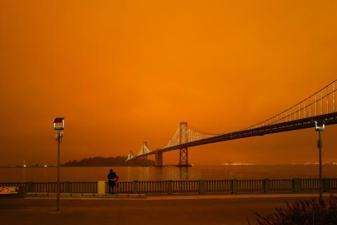Orange sky over the San Francisco Bay Bridge due to the West Coast wildfires. Photo by MILKOVÍ on Unsplash