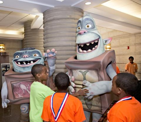 """Children greet """"Boxtroll"""" characters at the Charles H. Wright Museum of African American History."""