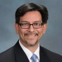 Headshot of Russell Castañeda-Calleros