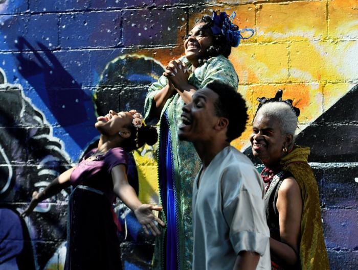 Members of the Black and Brown Theater perform in the alley at the Sidewalk Festival on Detroit's west side during the during the 12th Annual ARISE Detroit! Neighborhoods Day.