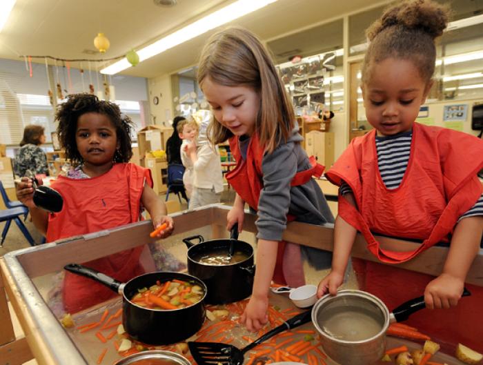 Little girls playing kitchen
