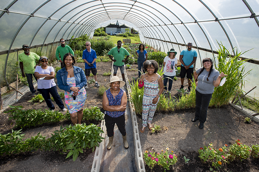 Mt. Olivet Neighborhood Watch members in hoop greenhouse