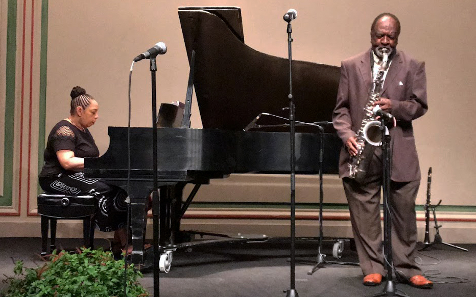 Wendell Harrison performs on saxophone, accompanied by his wife, Pamela Wise, on piano.