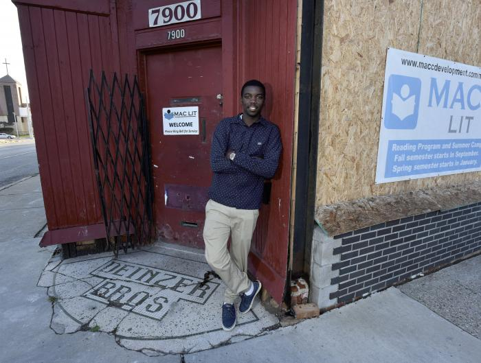 Ezekiel Harris in front of a building which is being renovated by Mack Avenue Community Church's development arm.