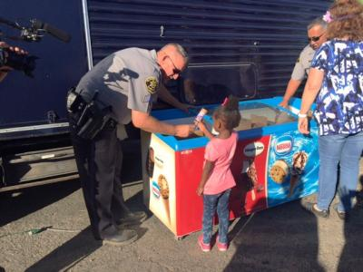 Sheriff's deputies hand out treats at Eden Night Live in Alameda, California