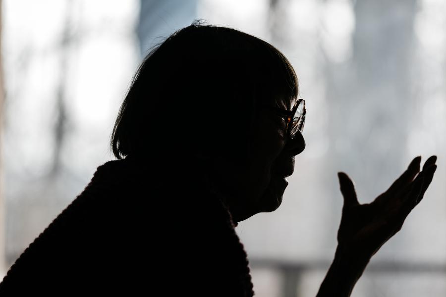 Marie Woo in silhouette