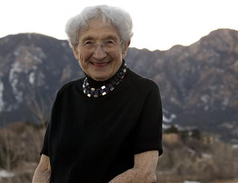 Ruth Adler Schnee sitting in front of mountains