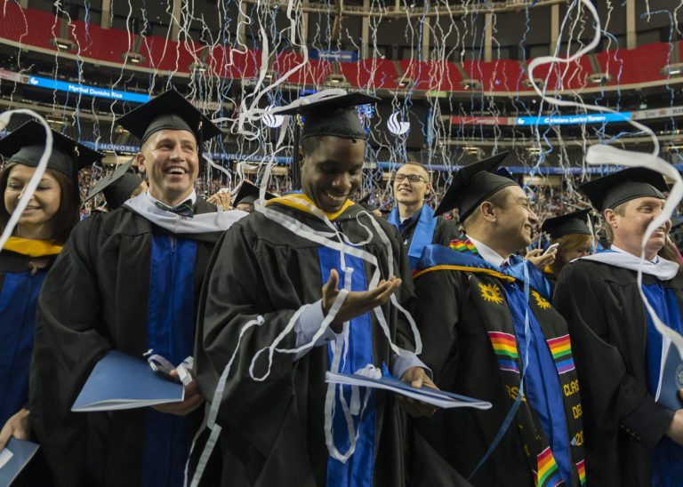 Georgia State University graduates celebrate during a Commencement ceremony