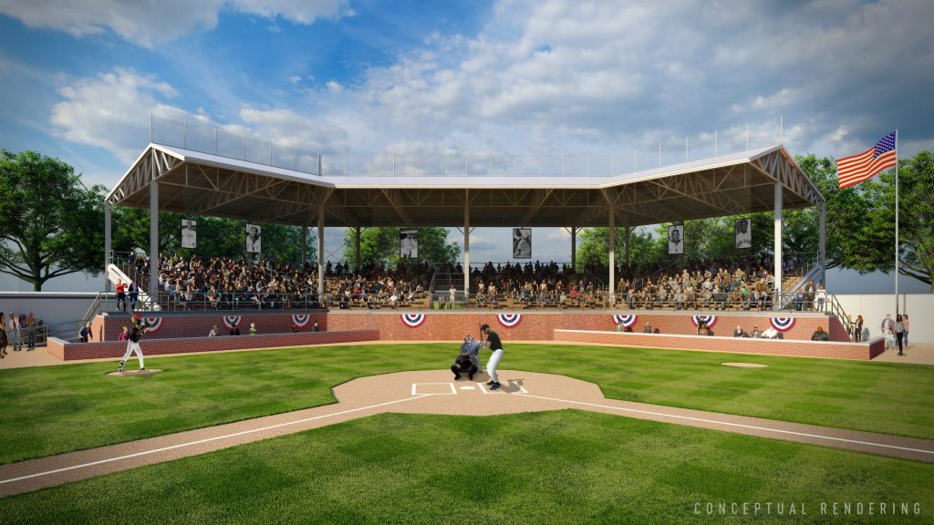 A conceptual rendering of a renovated Hamtramck Stadium, the former home of the Negro National League's Detroit Stars. The view is from the pitcher's mound and shows a batter at home plate, the catcher and an umpire. Behind them is the renovated stands that are covered and draped with circular flags and filled with fans.