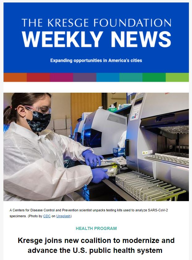 Blue graphic with the text: The Kresge Foundation Weekly News. Expanding opportunities in America's cities. Below is a photo of a Centers for Disease Control and Prevention scientist in a mask, gown and rubber gloves unpacking testing kits used to analyze SARS-CoV-2 specimens.